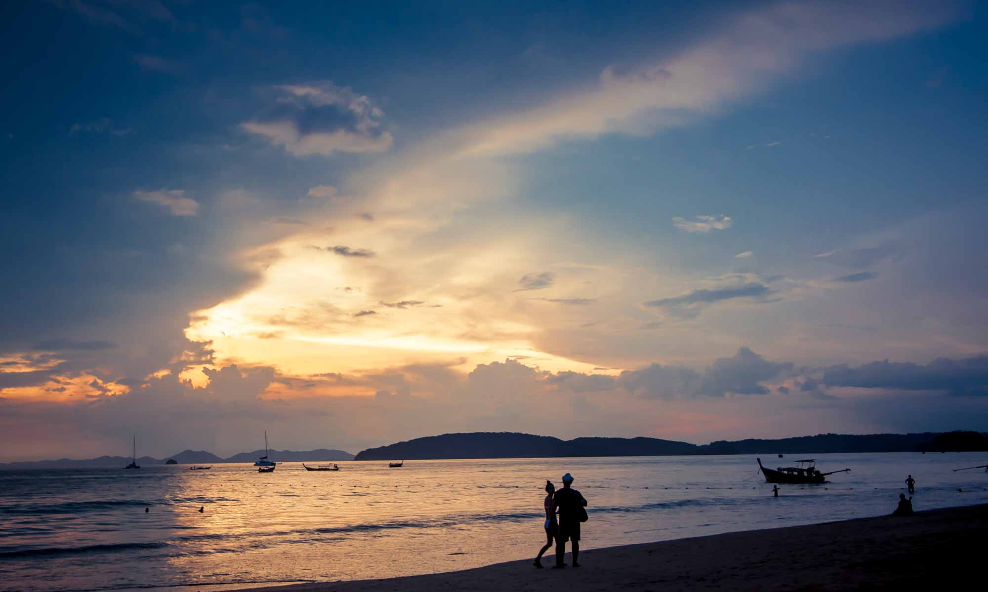 Travel Couple on Ao Nang Beach in Krabi Thailand