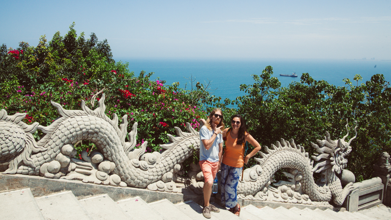 Adam and Gabby with a view of the sea at the Lady Buddha Temple on Son Tra Peninsula in Da Nang Vietnam