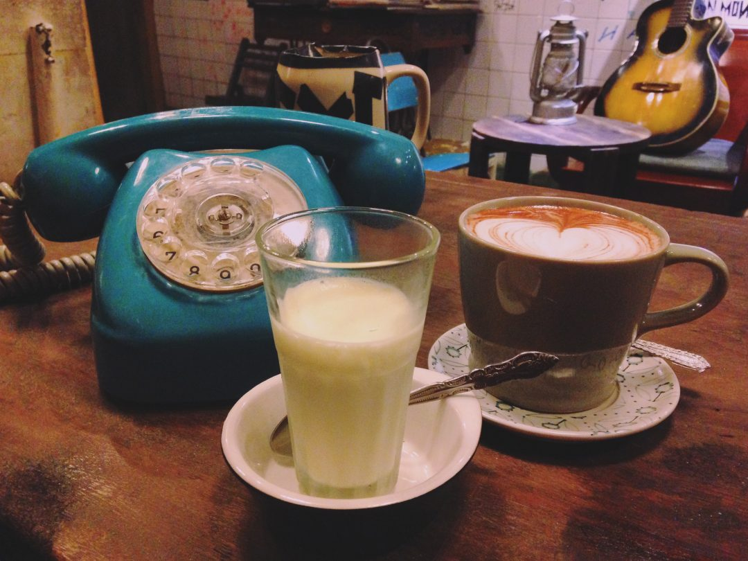 homemade Dalat Yaourt and a mug of hot cocoa in a cafe in Da Lat