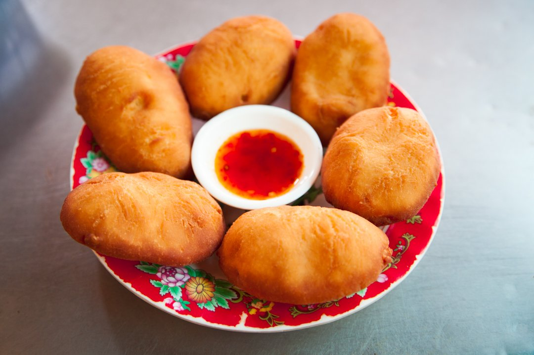 Banh Bo are an unlikely combo of sweet fried donut and chili jam a sweet treat in Viet cuisine
