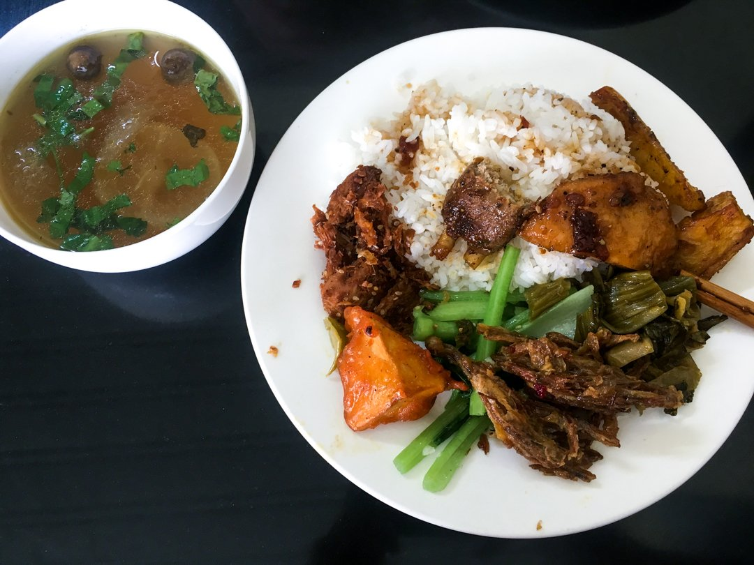 Com Chay a plate of rice with mixed vegetables and tofus at a Buddhist Vegetarian Restaurant in Vietnam