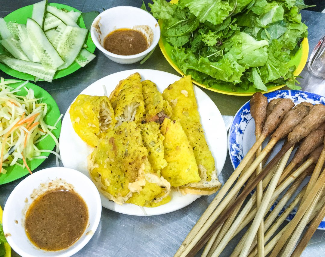 "Banh Xeo or ""sizzling cakes"" are rice flour pancakes with a twist, one of the most immersive vietnamese dishes we've eaten"