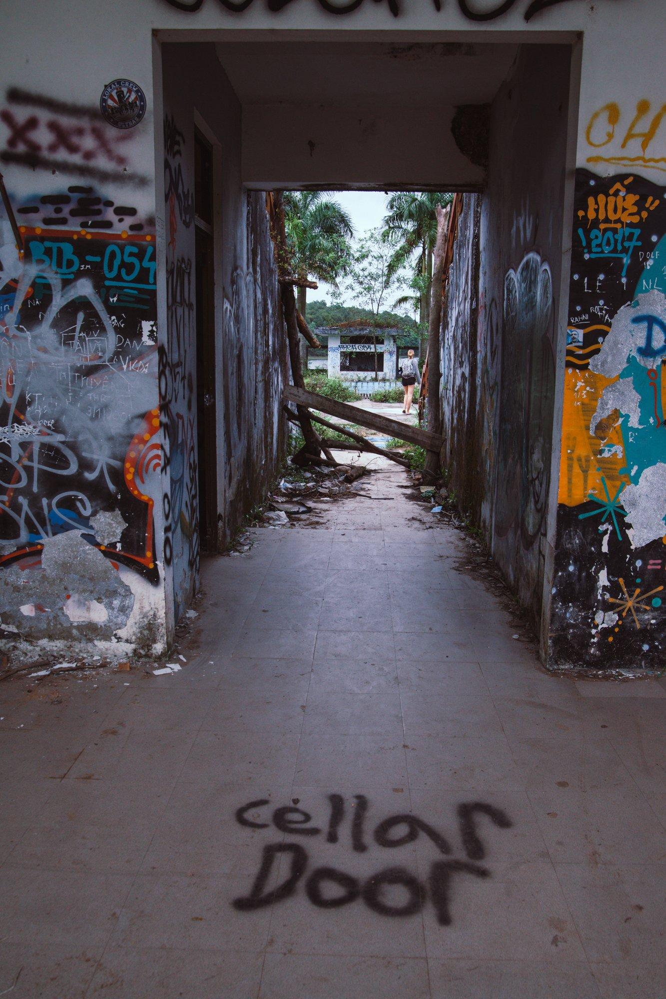 Cellar Door graffiti at the abandoned waterpark in Hue