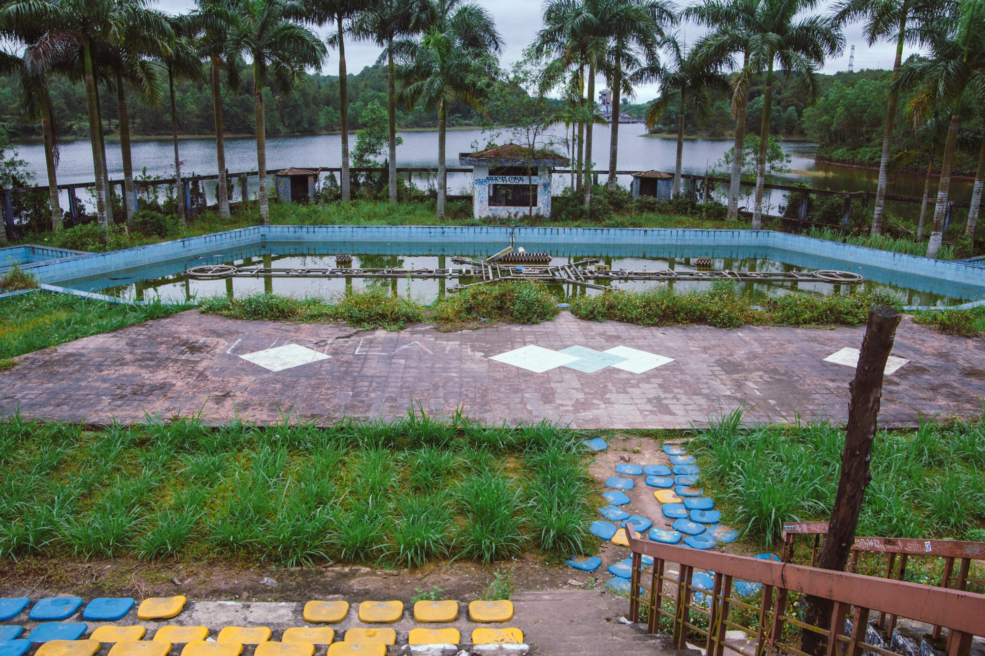 Stadium around a pool on the lake at the abandoned waterpark hue, vietnam