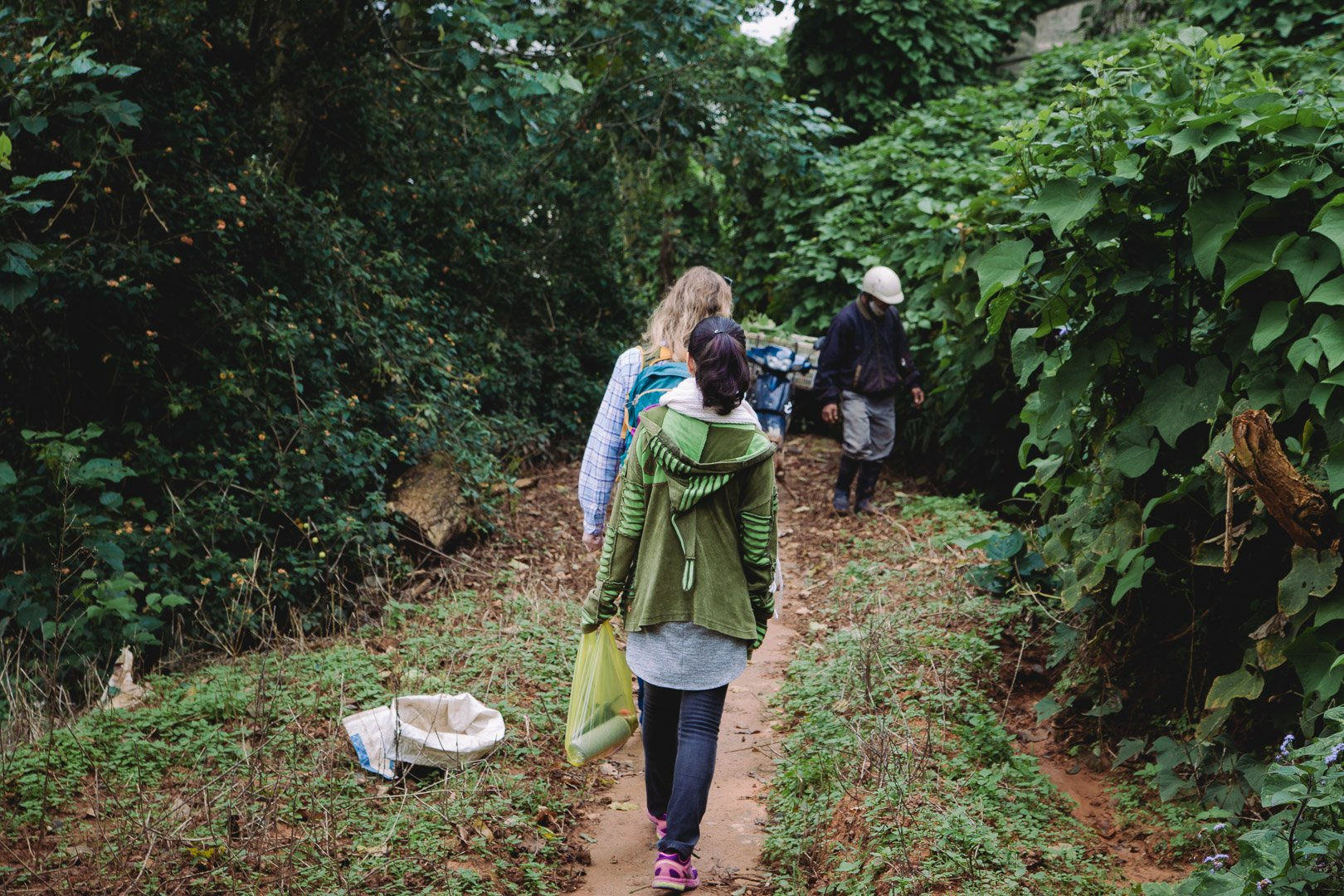 Walking the muddy paths of the Dalat coffee farm
