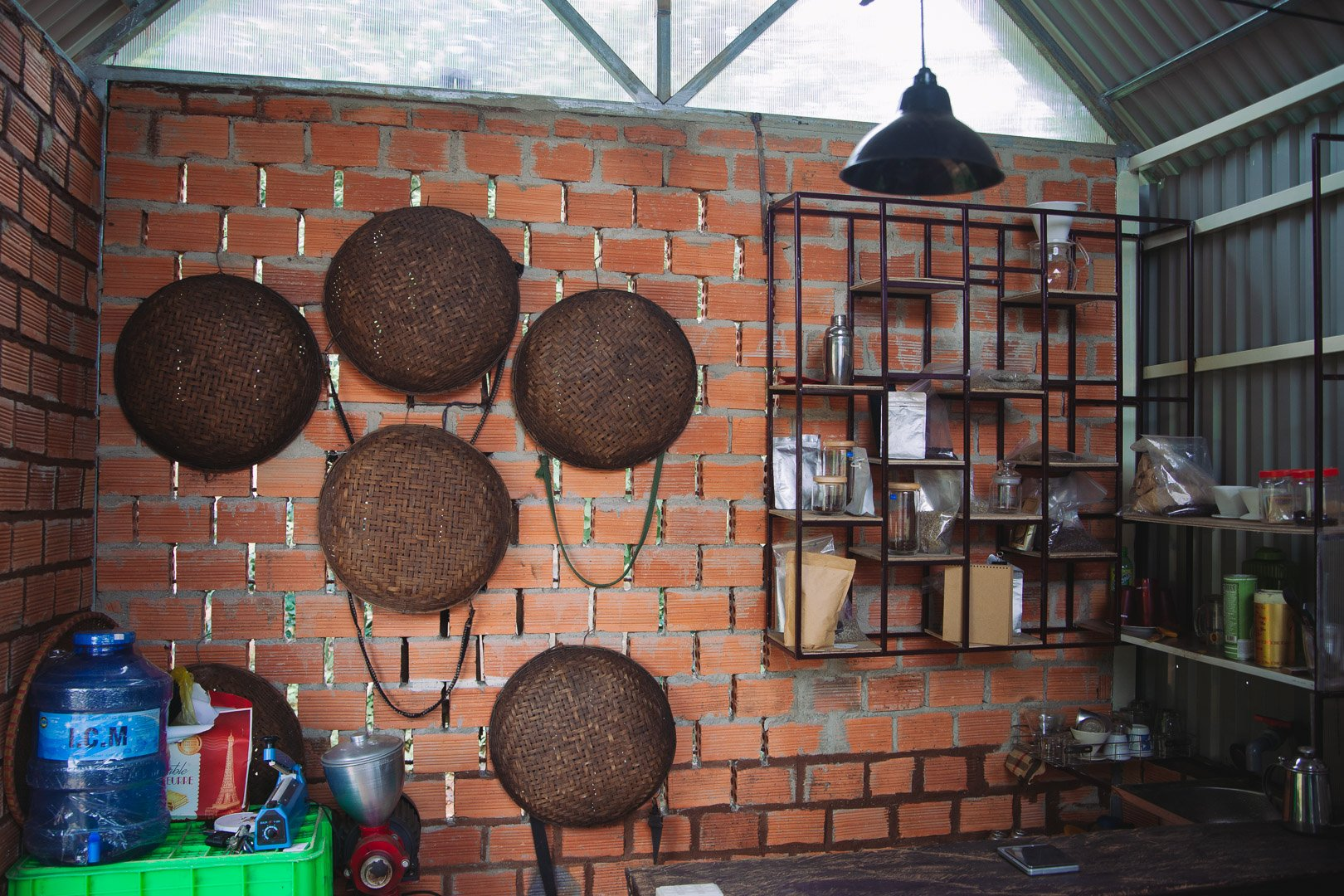 Inside the coffee workshop, coffee picking baskets hang on the wall