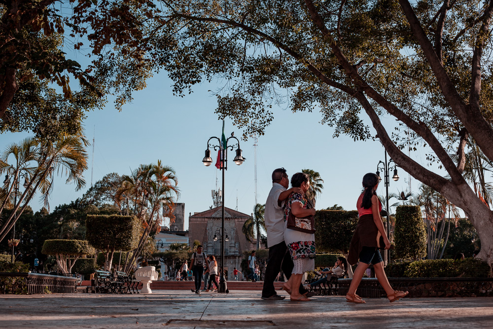 couples strolling the plaza grande in Merida, Mexico