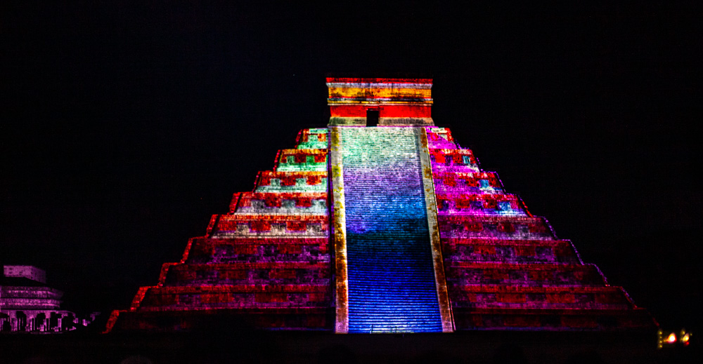 Rainbow lights shine on Chichen Itza pyramis