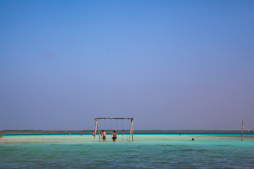 Wooden swings in the water at Lake Bacalar, Mexico