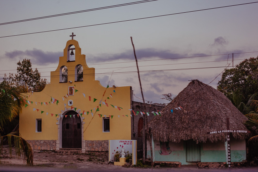 Colonial church with mayan palapa house