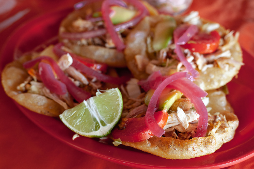 salbutes, fried tortillas topped with turkey and onion