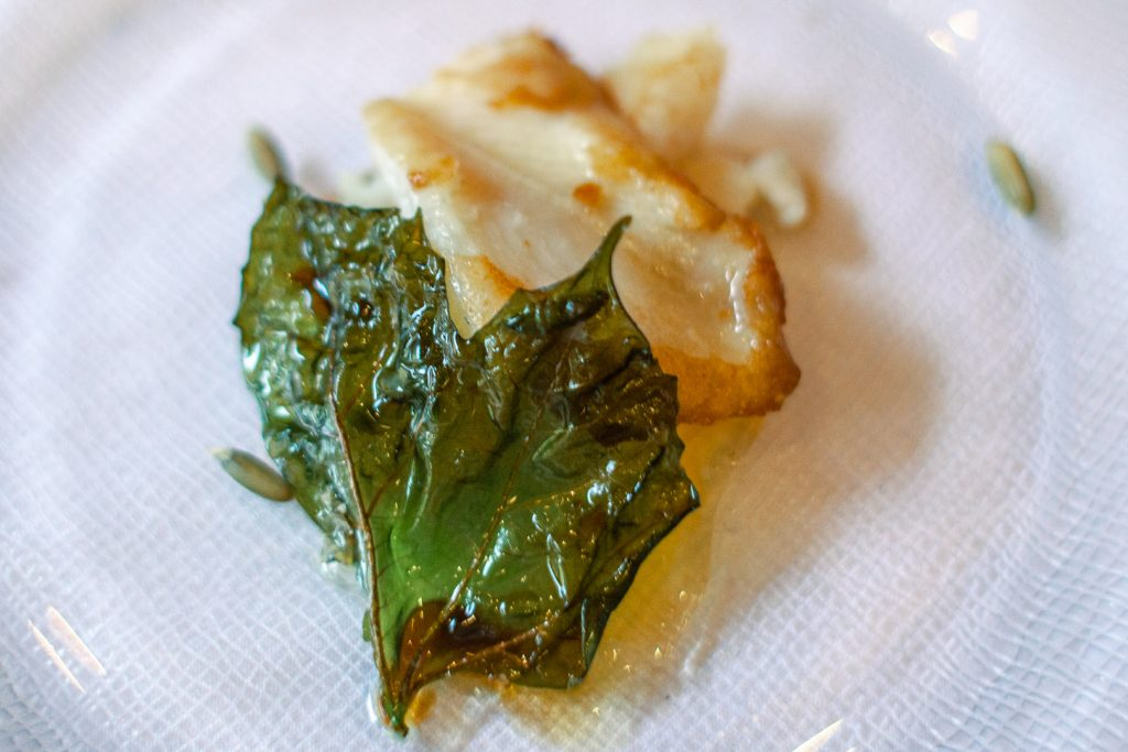 plate with fried grouper and chaya leaf