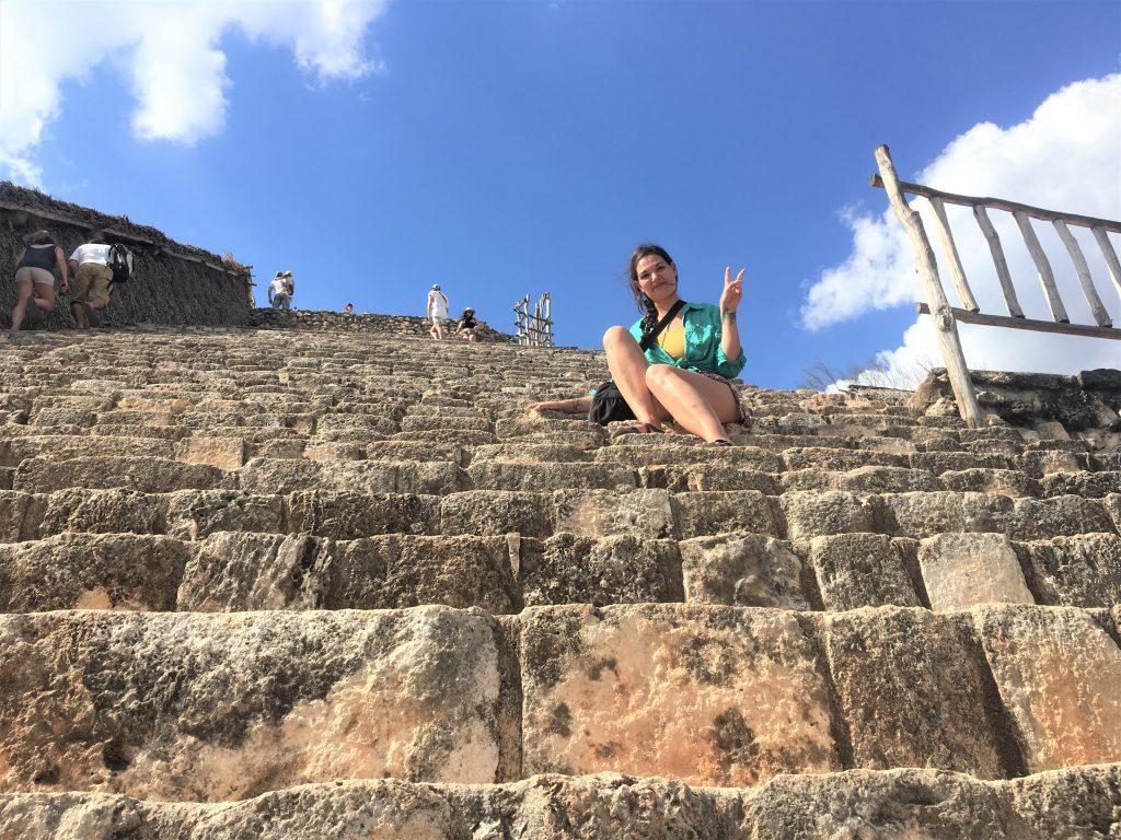 Gabby sits on Ek Balaam pyramid stairs