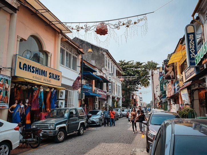 Silk shops and restaurants on a street in Little India in Georgetown Penang