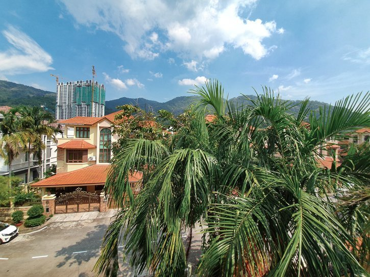 Houses in a residential area in Batu Ferringhi, Penang with mountains in the background