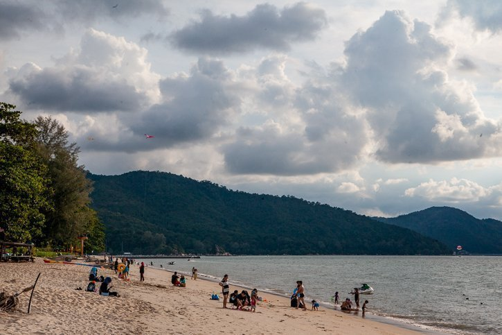 Families at the beach in Batu Ferringhi, Penang