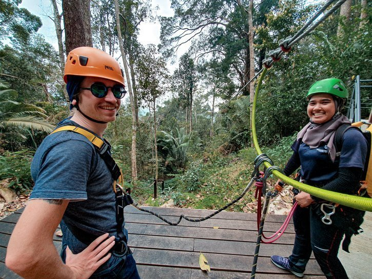Adam and our guide on the zipline platform at the Habitat at Penang Hill