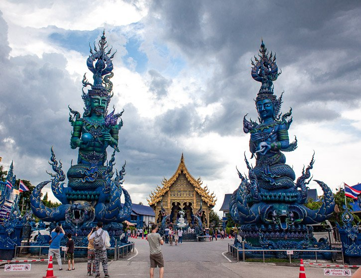 Standing outside the gates of the Blue Temple in Chiang Rai Thailand